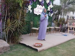 women in abaya giving speech